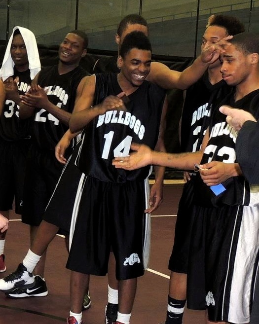 Teammates coming together during a CAAEL basketball game