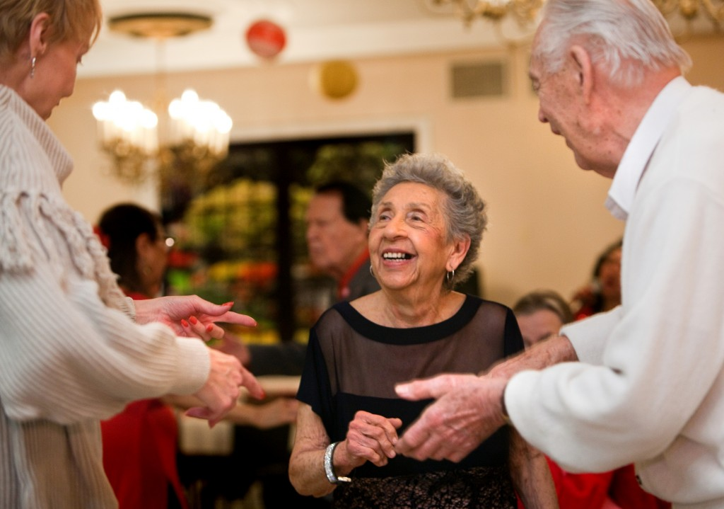 Lee Wright, center, dances with new friends George Baranowski and Sandy Domino during Oak Park Arms Valentine's Day Ballroom Dance with music by The Freenotes orchestra Sunday, February 14, 2016, in Oak Park.