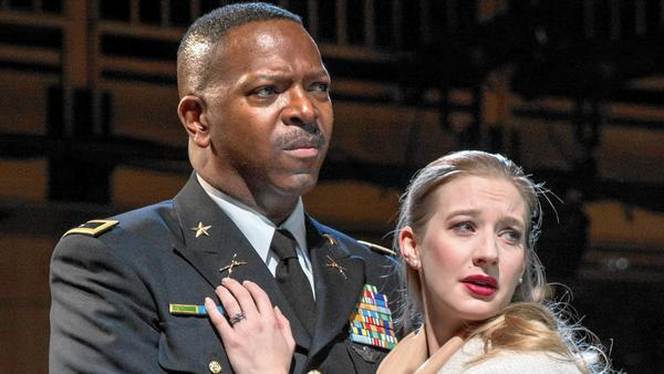 James Vincent Meredith as Othello and Bethany Jillard as his bride, Desdemona, in Chicago Shakespeare Theater's army base-set production of